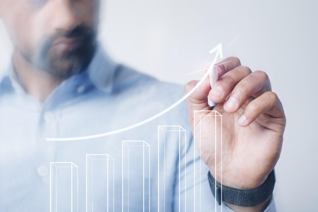 Man giving a business presentation using a high technology digit